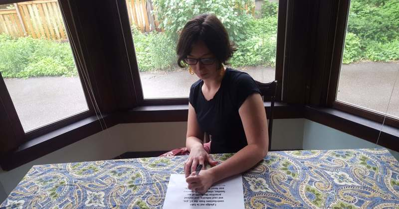 Jen signing the No Fossil Fuel Pledge